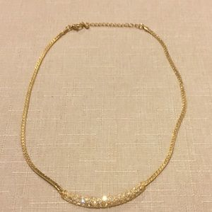 Gold and cubic zirconium diamond necklace.